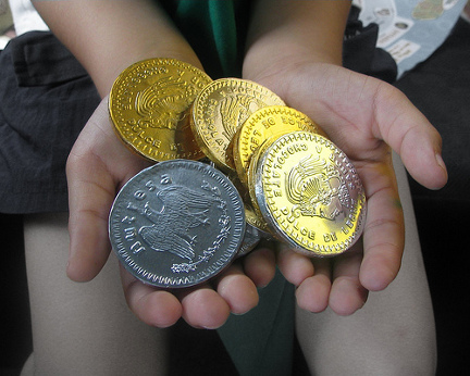 Coins in child\'s hands