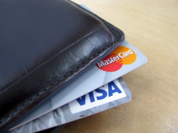 Visa and MasterCard poking out of a wallet
