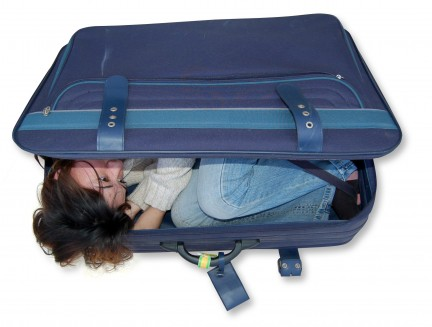 suitcase girl hiding